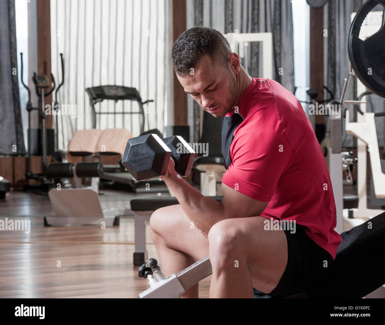 handsome young muscular man in a fitness gym - Stock Image
