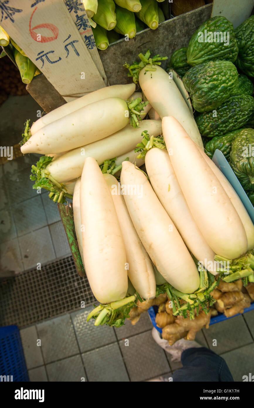 Large white winter radish on sale at market - Stock Image