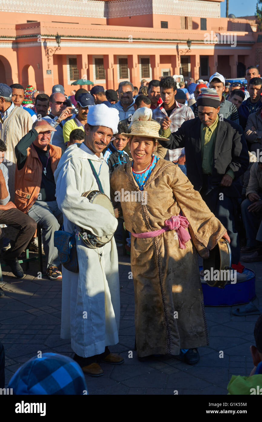 Traditional street entertainers performing  in the Jemaa el-Fnaa square in  Marrakech, Morocco. A UNESCO World Heritage - Stock Image
