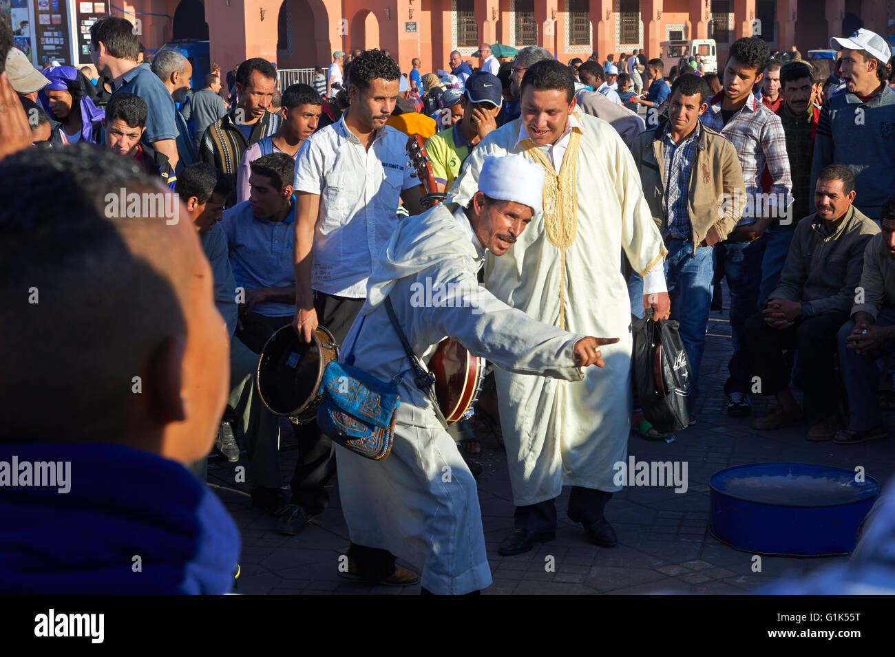 Traditional street entertainers performing  in the Jemaa el-Fnaa square in  Marrakech, Morocco. A UNESCO World Heritage - Stock Photo