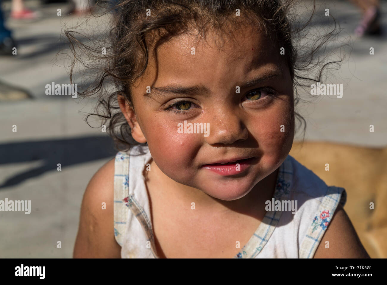 Little girl with messy face, Feria de Mataderos, Buenos Aires, Argentina - Stock Image