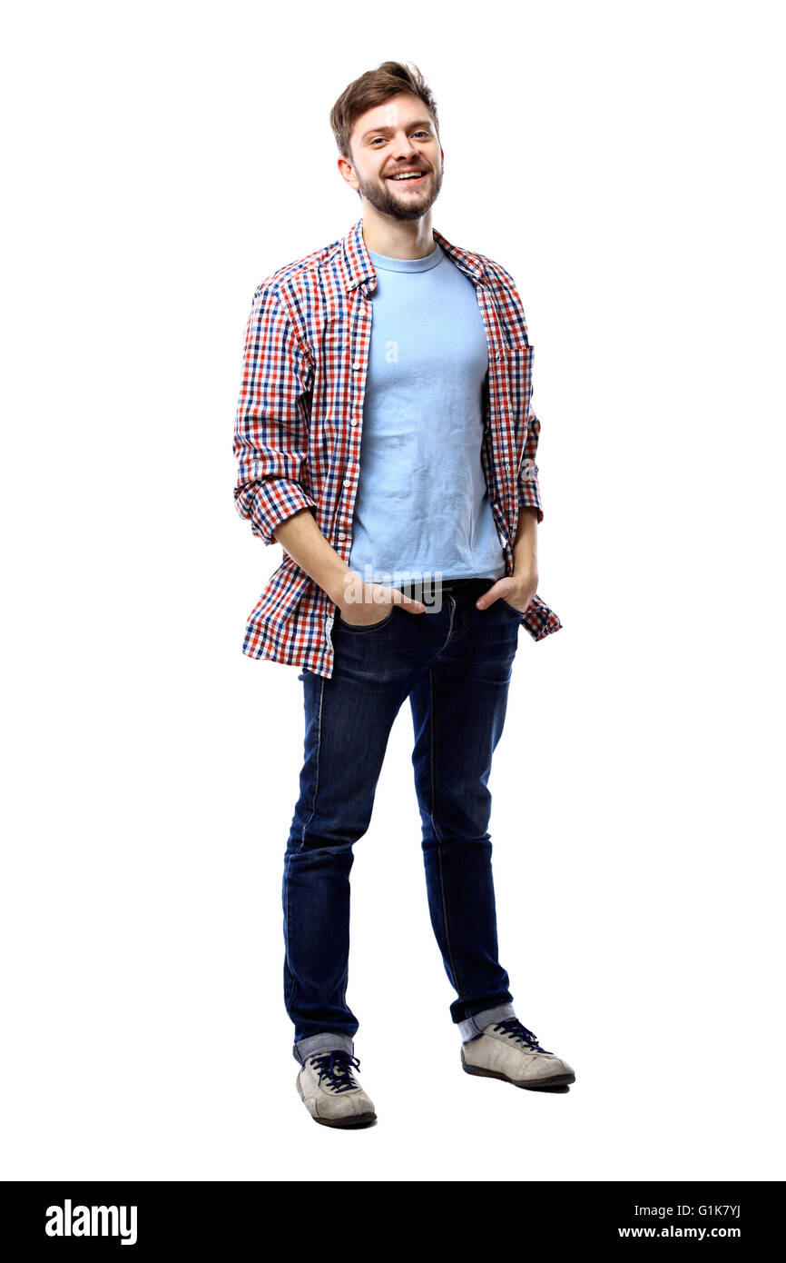 Full length of a cute young man in jeans and t-shirt looking at the camera - Stock Image