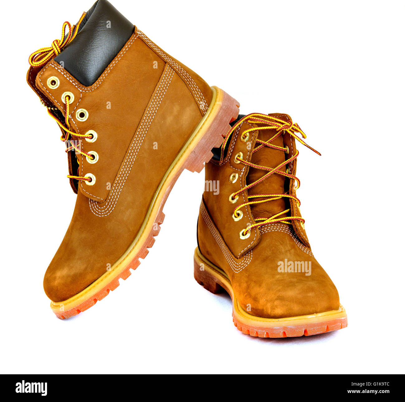 Brown lady's boots with shoelace on white background. - Stock Image
