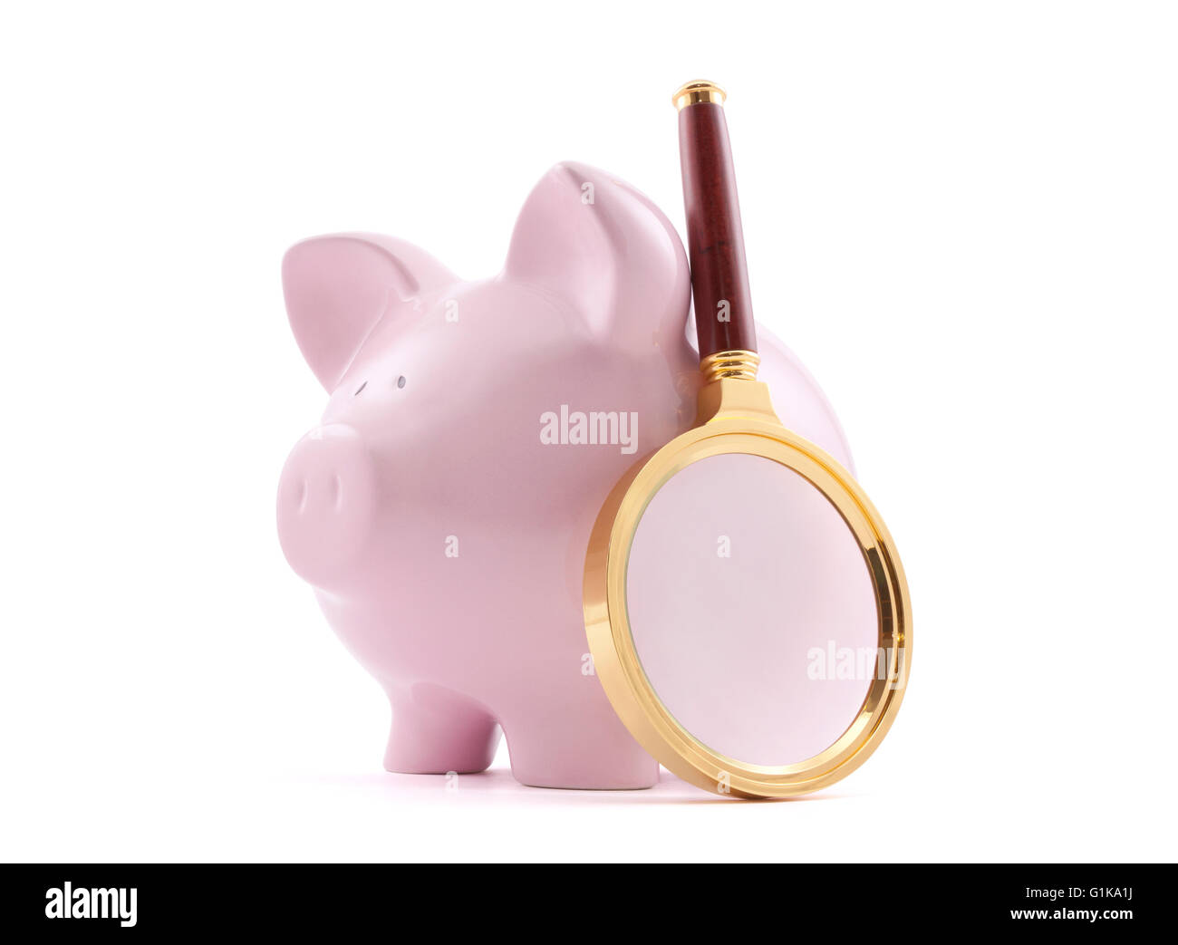 Piggy bank with magnifying glass. Clipping path included. - Stock Image