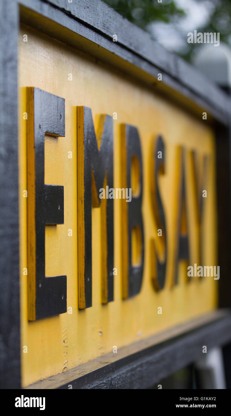 The station name board at Embsay station on the preserved Embsay and Bolton Abbey Railway - Stock Image
