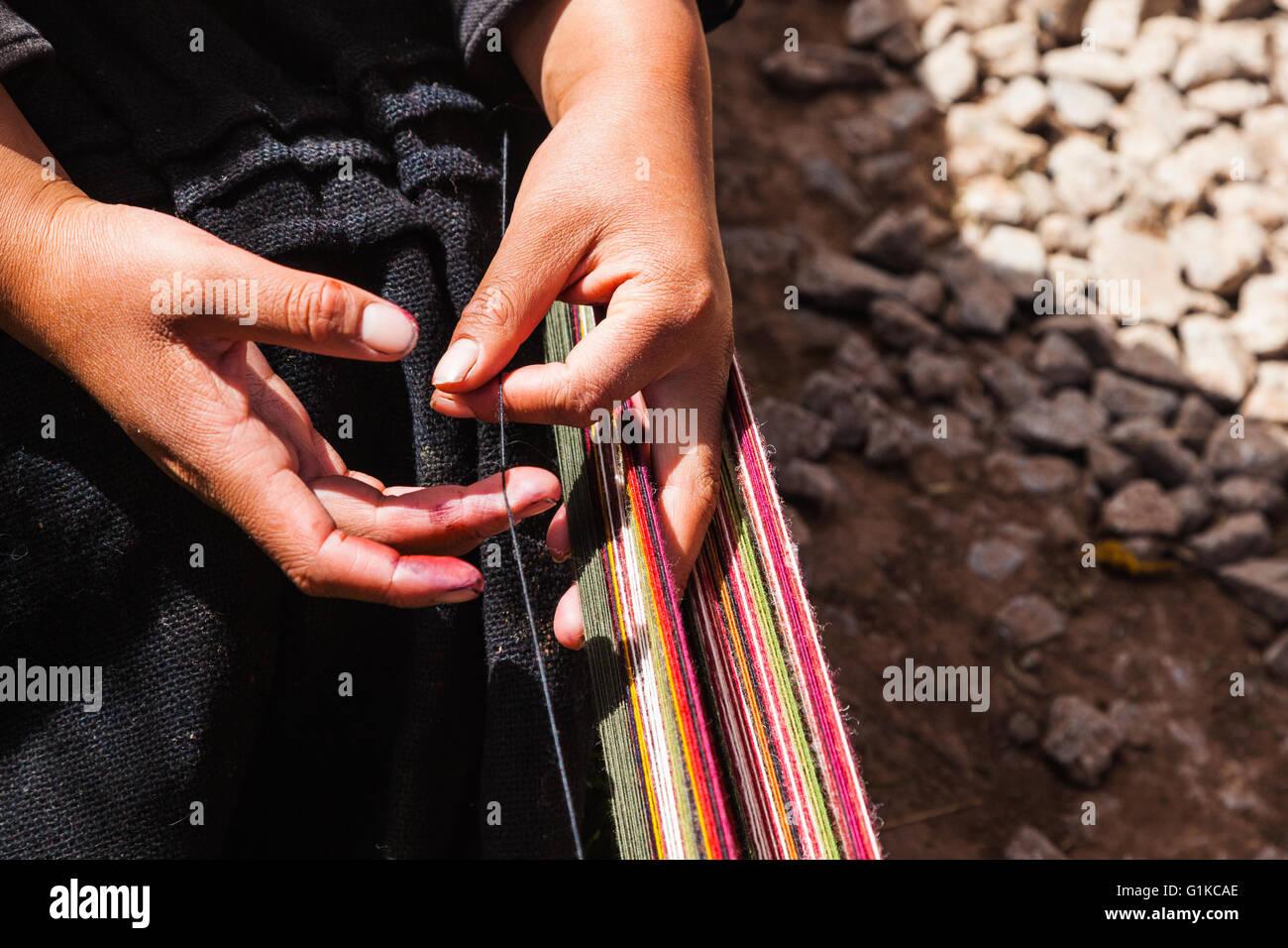 Preparing the warp threads before the start of weaving - Stock Image