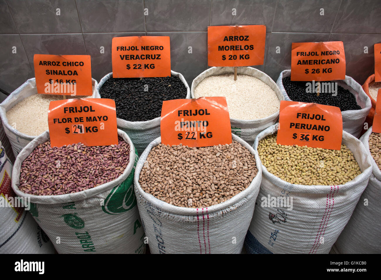 Sacks of various grains for bulk sale in a mexican market. Mexico. - Stock Image