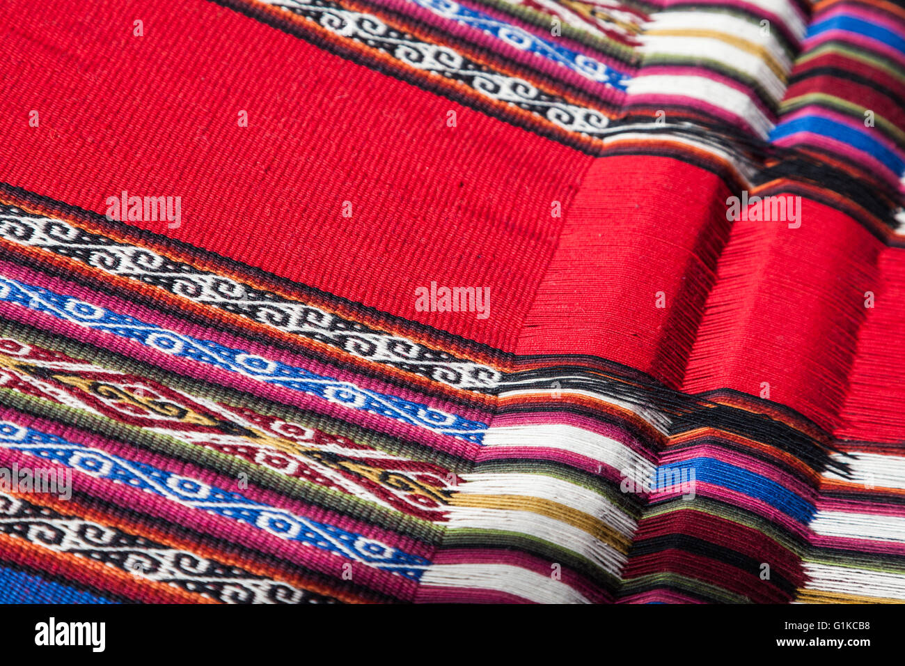 Abstract image of a hand woven table runner in the village of Chinchero, Peru - Stock Image
