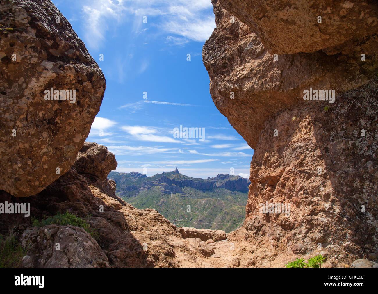 Gran Canaria, view towards Roque Nublo from caves Cuevas de Caballero at cliff Risco Chapi Stock Photo