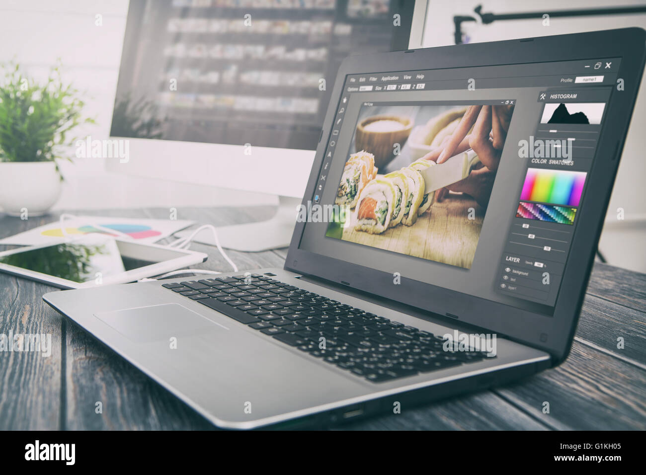 photographer camera editor monitor design laptop photo screen photography - stock image - Stock Image