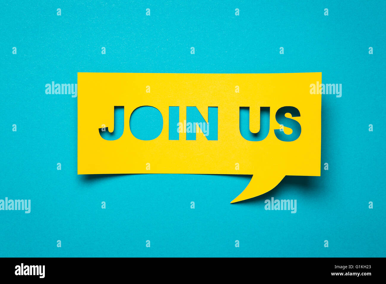 Bubble speech with cut out phrase 'join us' in the paper. - Stock Image