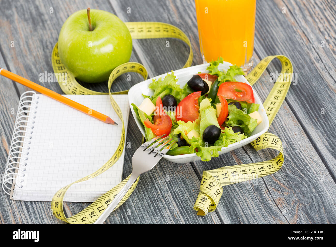 Workout and fitness dieting copy space diary on wooden table. - Stock Image