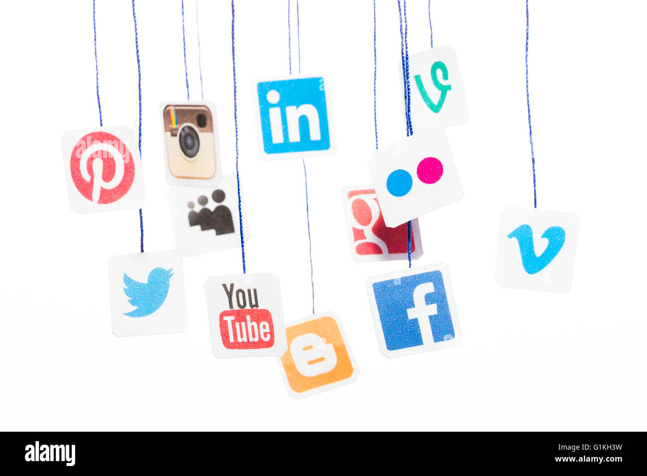 BELCHATOW, POLAND - AUGUST 31, 2014: Popular social media website logos printed on paper and hanging on strings. - Stock Image