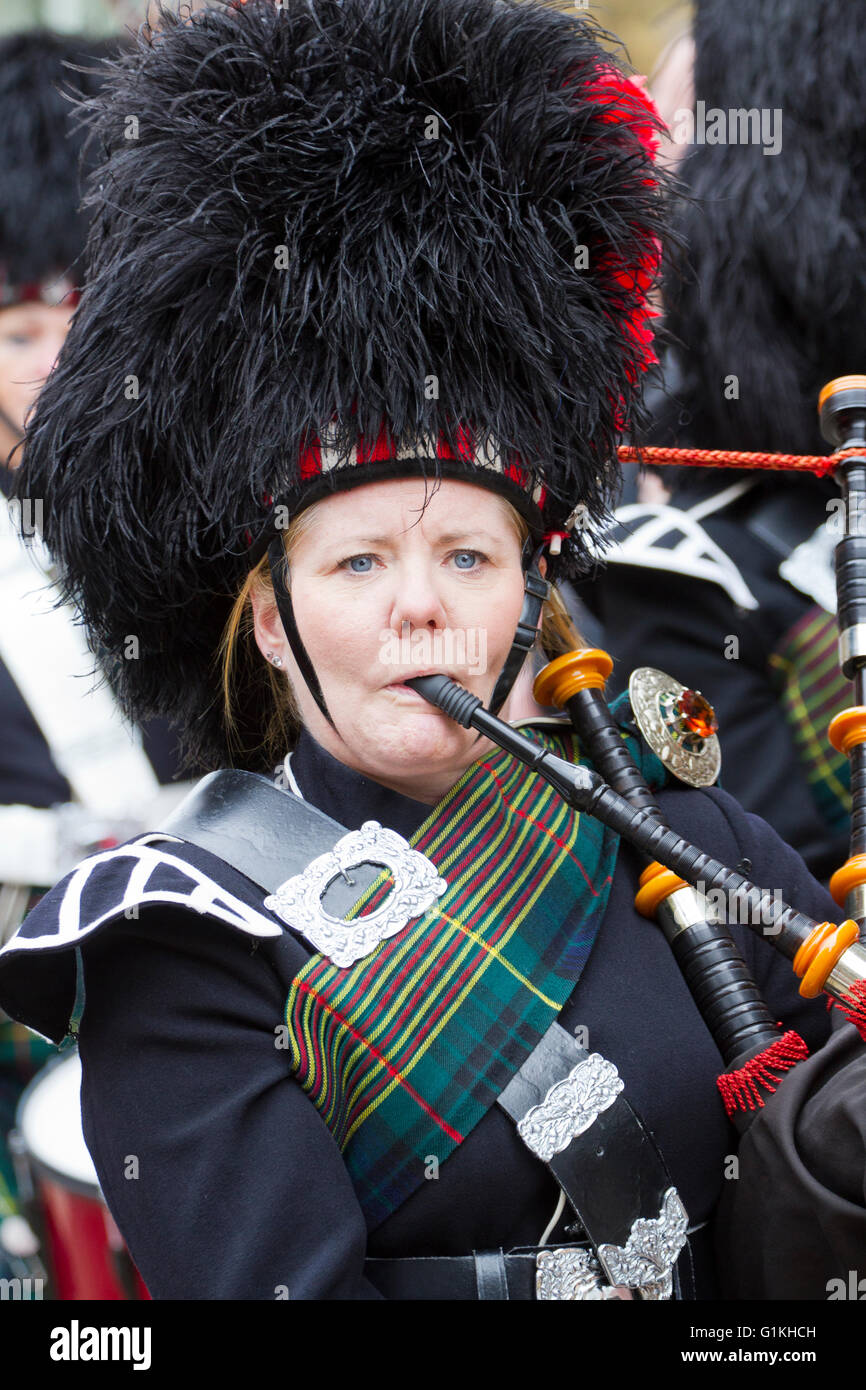 Female, Scottish pipe play at event in Haworth, Yorkshire, UK - Stock Image