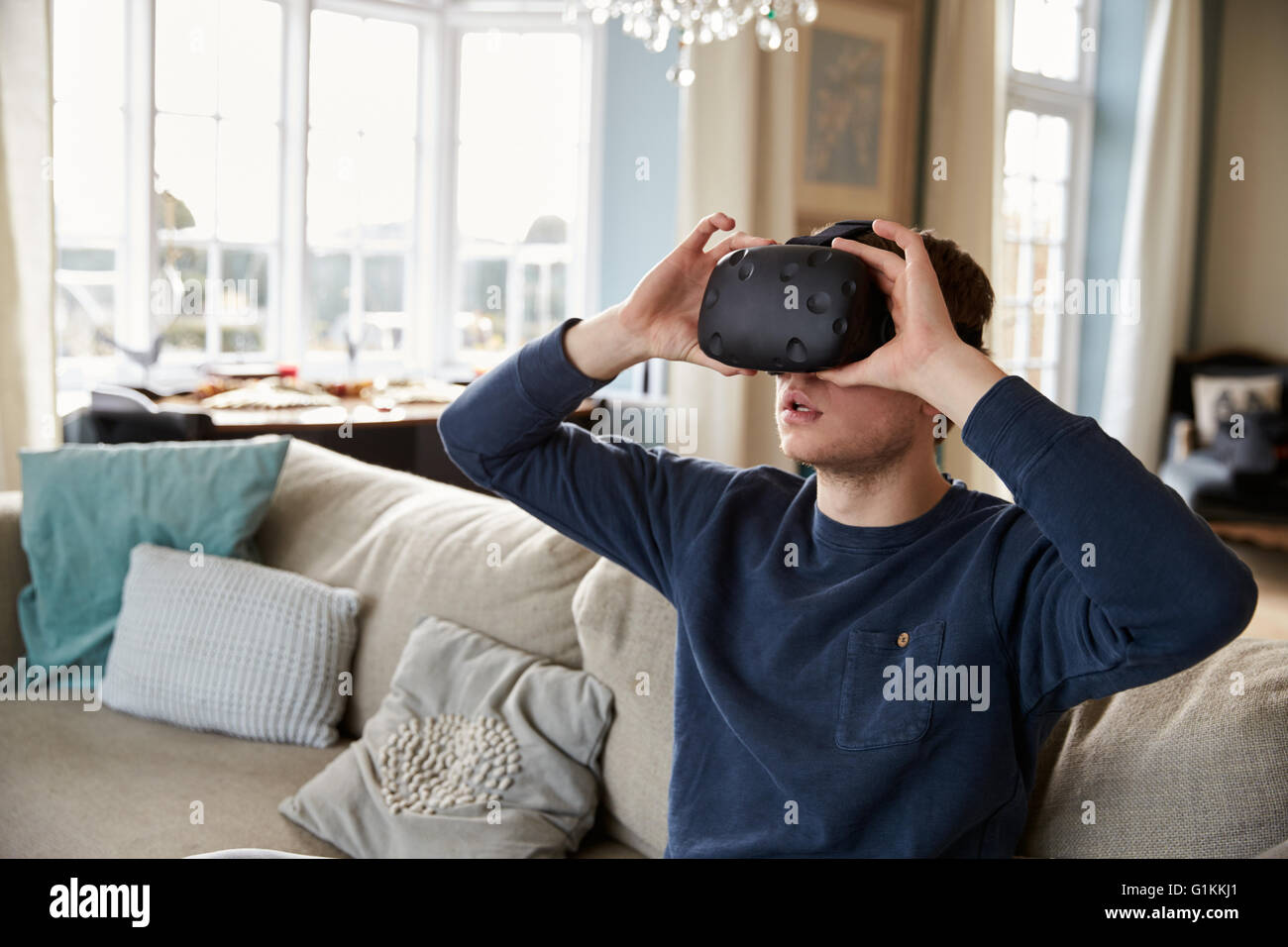 Young Woman Wearing Virtual Reality Headset In Studio - Stock Image