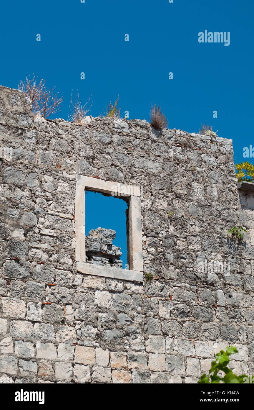 Wall of old building. Fragment of architecture in Korcula, Croatia. Vertical photo - Stock Image