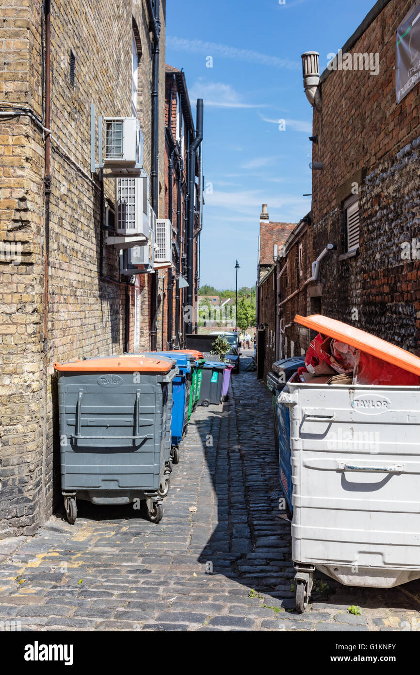 Waste and recycling bins in an historic Alley 'Bell Lane', Sandwich, Kent, England, UK - Stock Image