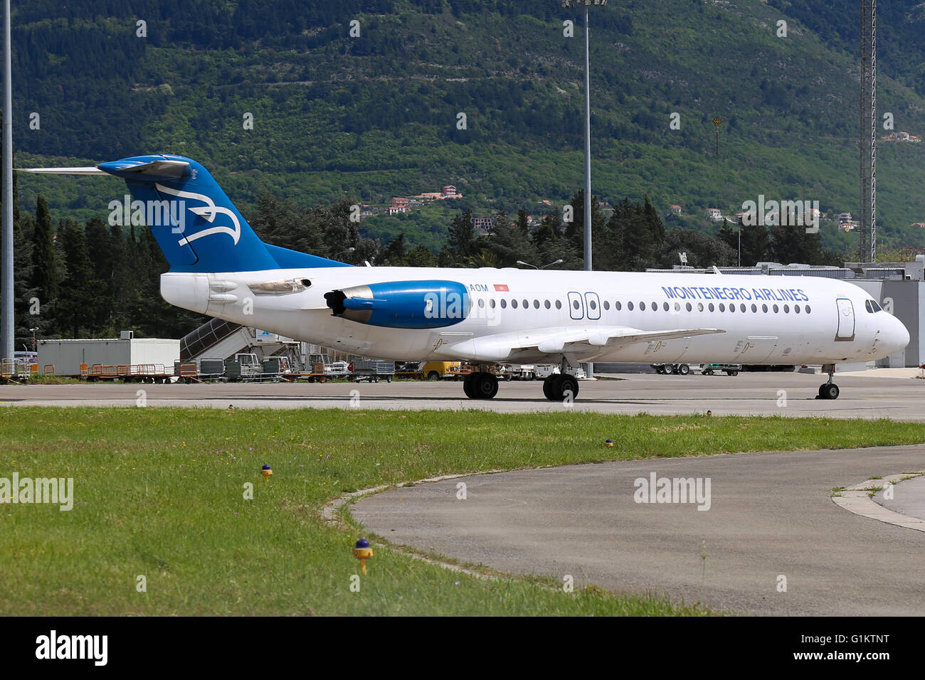 Montenegro Airlines Fokker 100 parked up at Tivat airport. Stock Photo