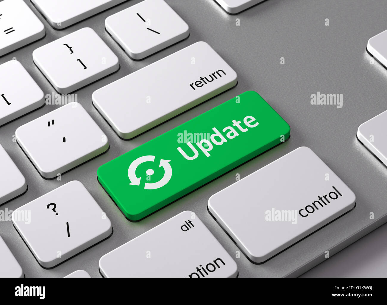A keyboard with a green button Update - Stock Image