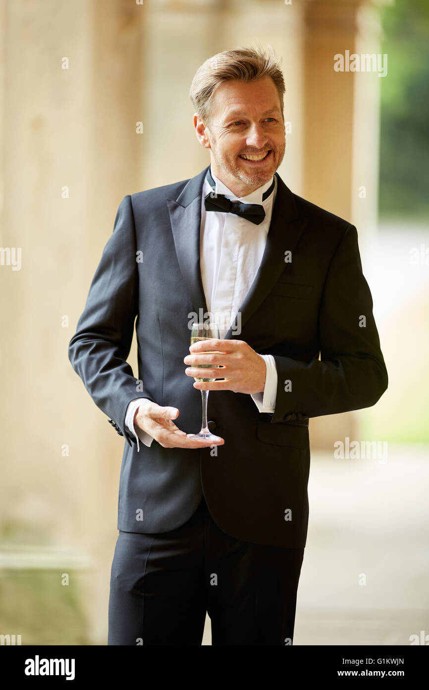 Man wearing a tuxedo suit - Stock Image