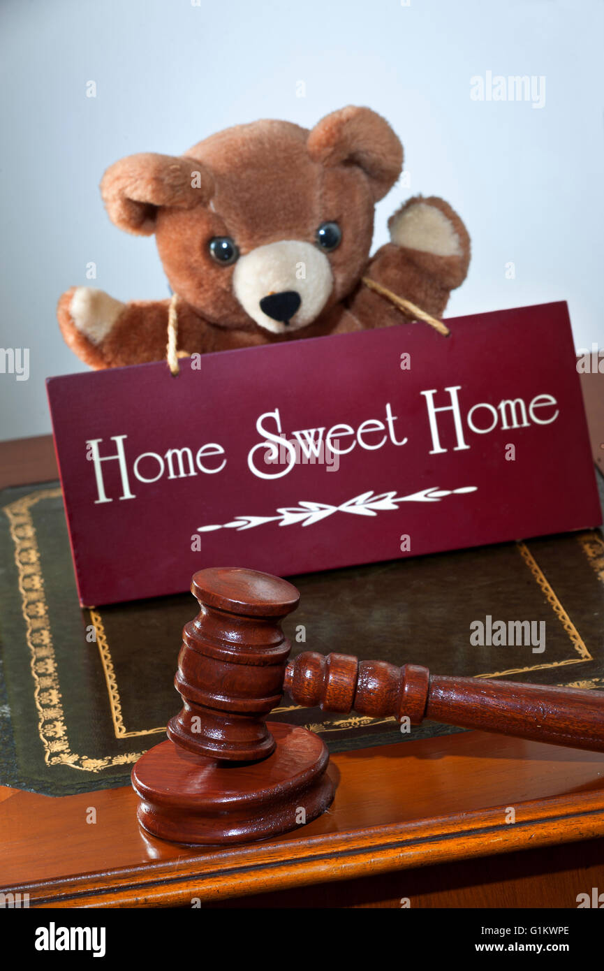 House sale by auction/law concept, auctioneers hammer & 'Home Sweet Home' sign  with child's appealing - Stock Image