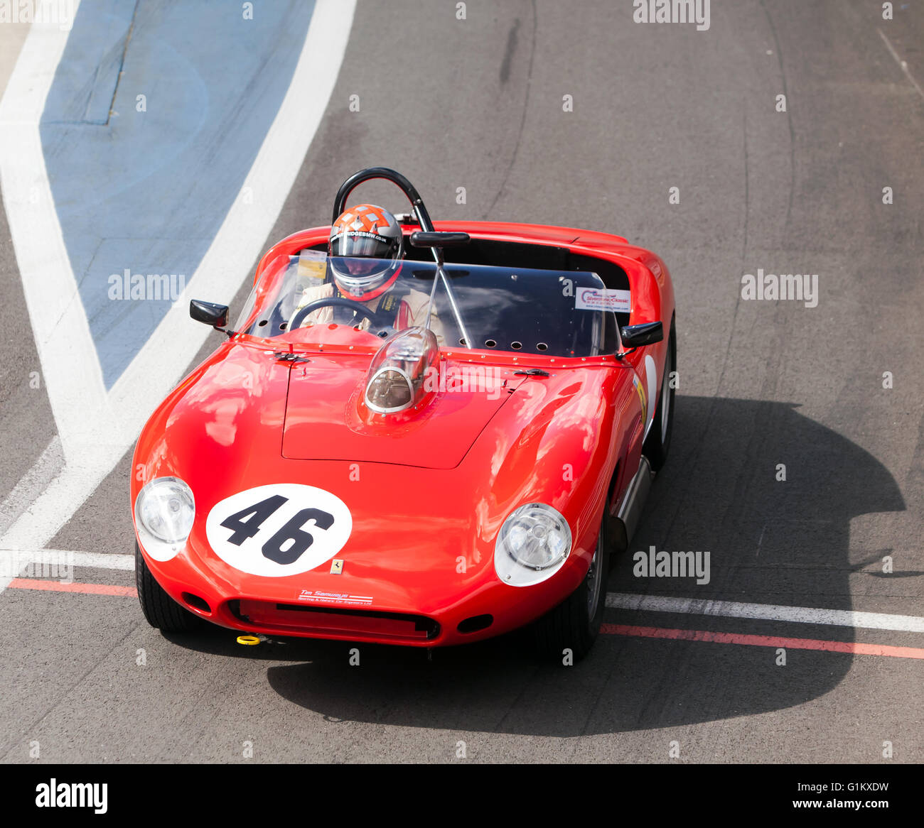 A 1960, Ferrari 246S Dino, driven by Bobby Verdon-Roe, leaving the pits,  at the Silverstone Classic Media Test - Stock Image