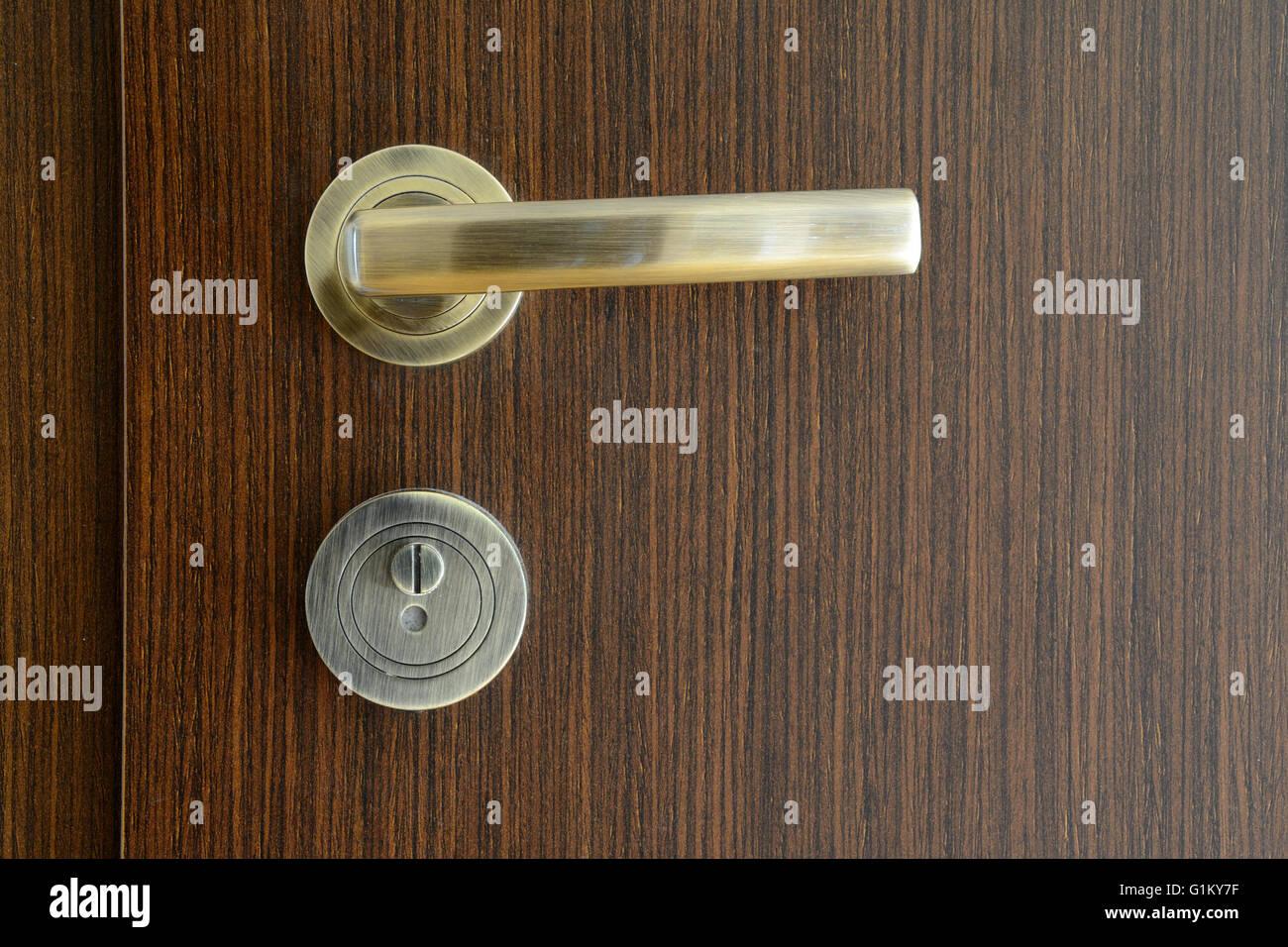 modern door handles. Golden, Modern Door Handle On Brown Wooden Door. - Stock Image Handles O