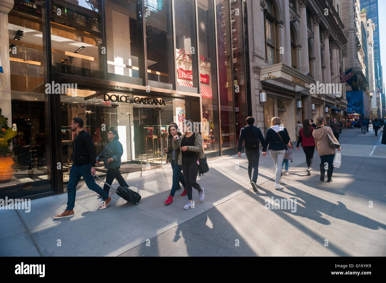 fc25f5ce09 Shoppers pass the Dolce and Gabbana store on Fifth Avenue in Midtown  Manhattan in New York