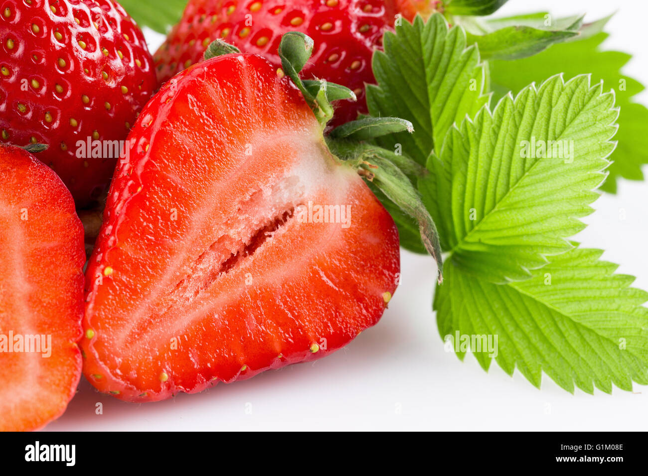 tasty strawberries isolated on the white background. - Stock Image