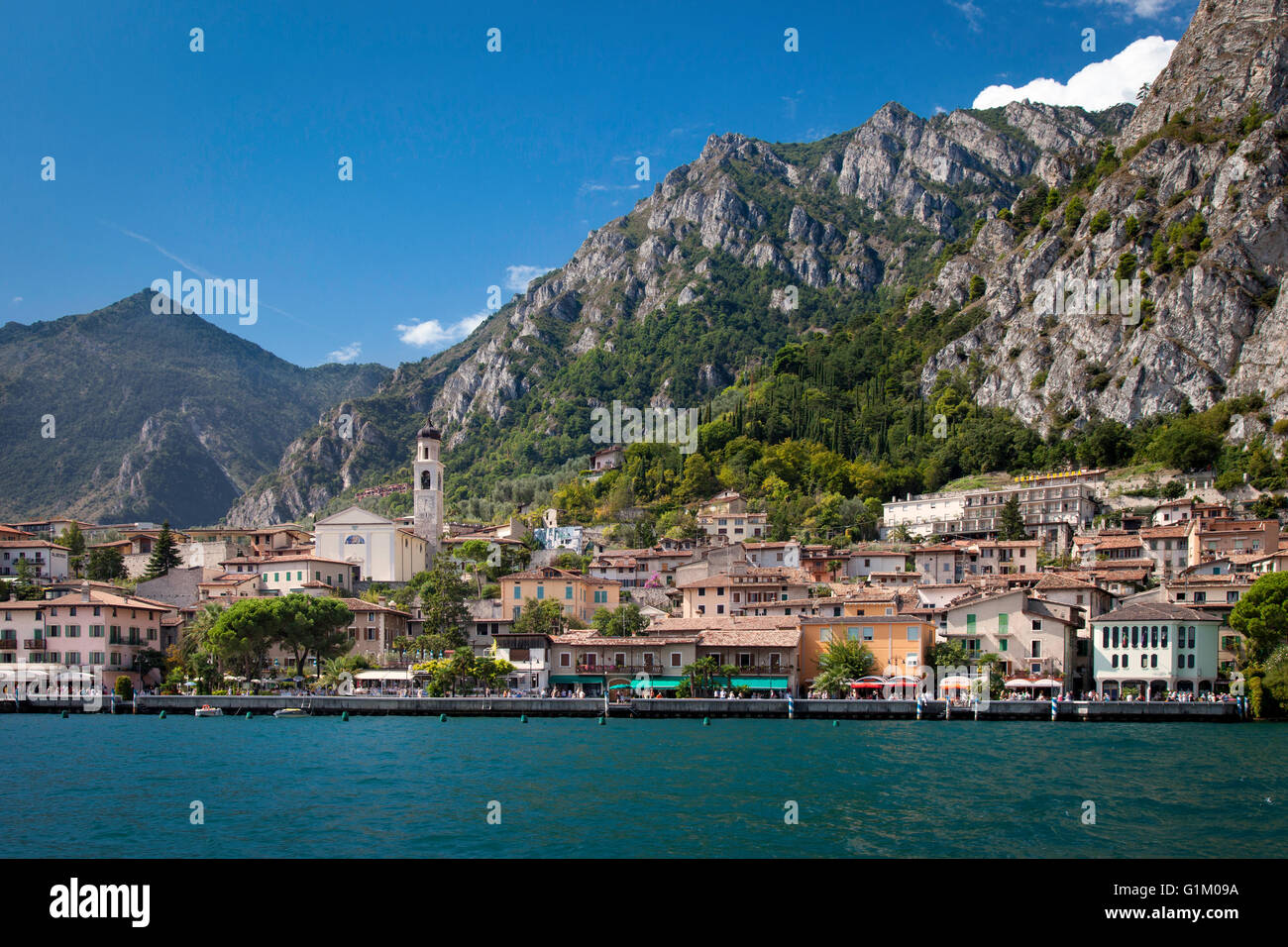 Massive cliffs tower over Limone-sul-Garda along the shores of Lake Garda, Lombardy, Italy - Stock Image