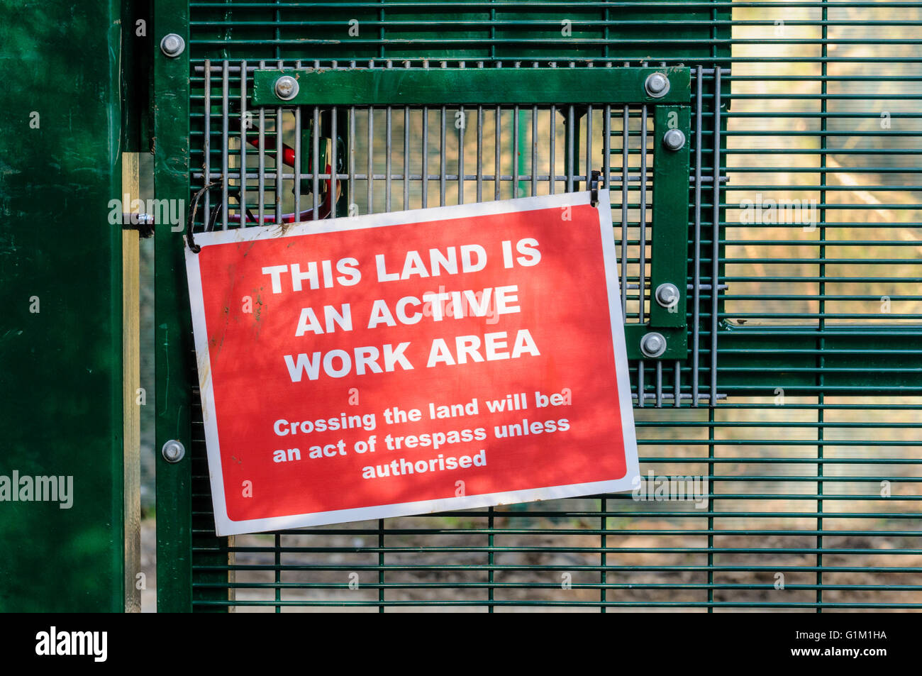 Security sign on a fence at a secure work site - Stock Image