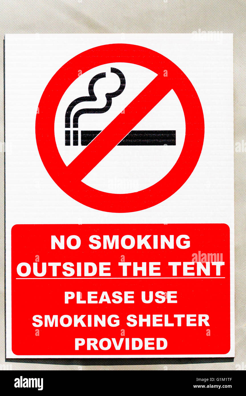No smoking sign on a tent at a camp site, advising people to use the smoking shelter provided. - Stock Image