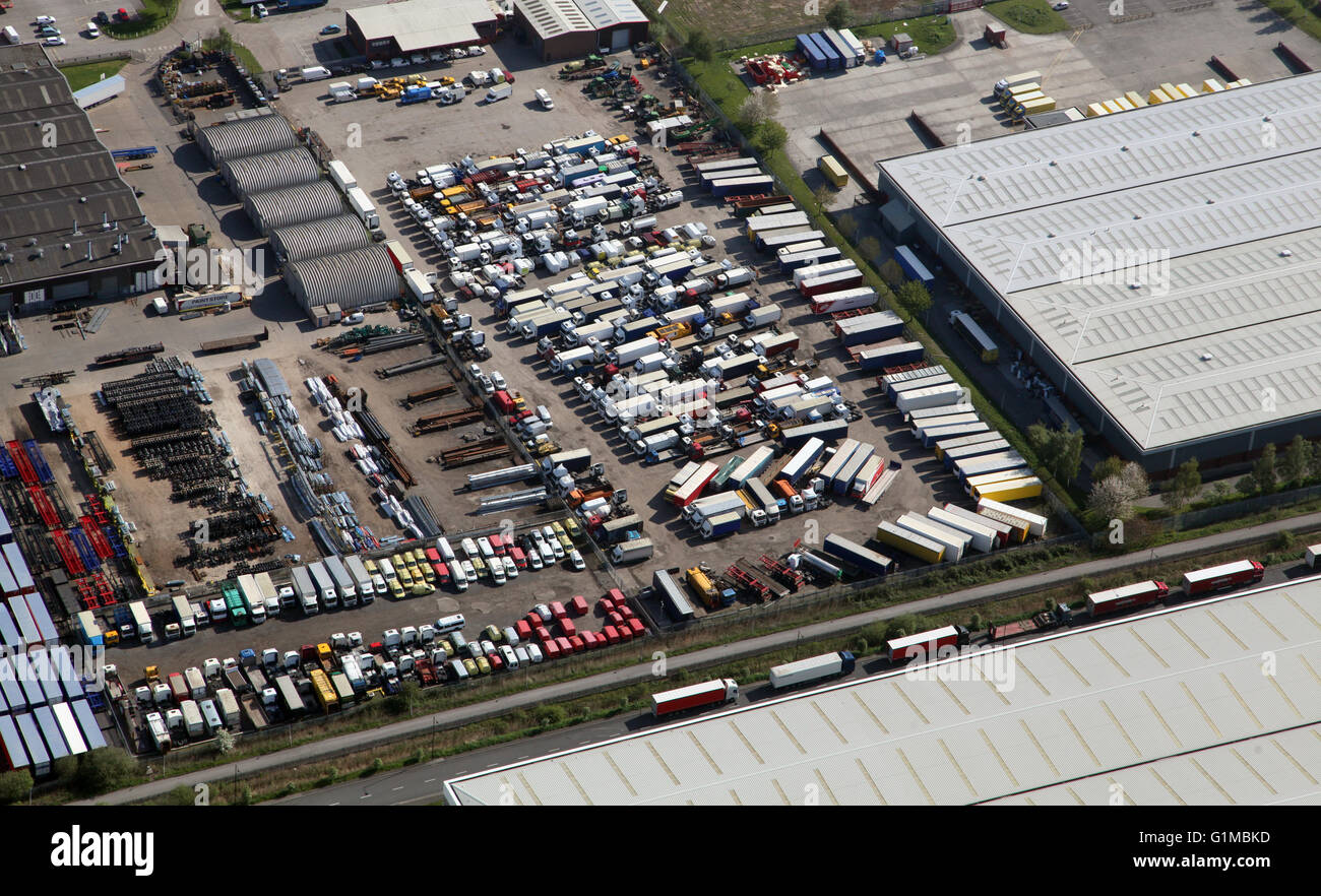 aerial view of a compound yard full of old trucks and vehicles - Stock Image