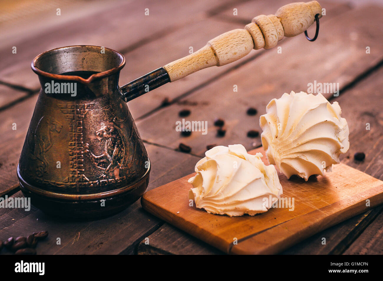 The Turk with coffee and white marshmallows on the wooden table - Stock Image