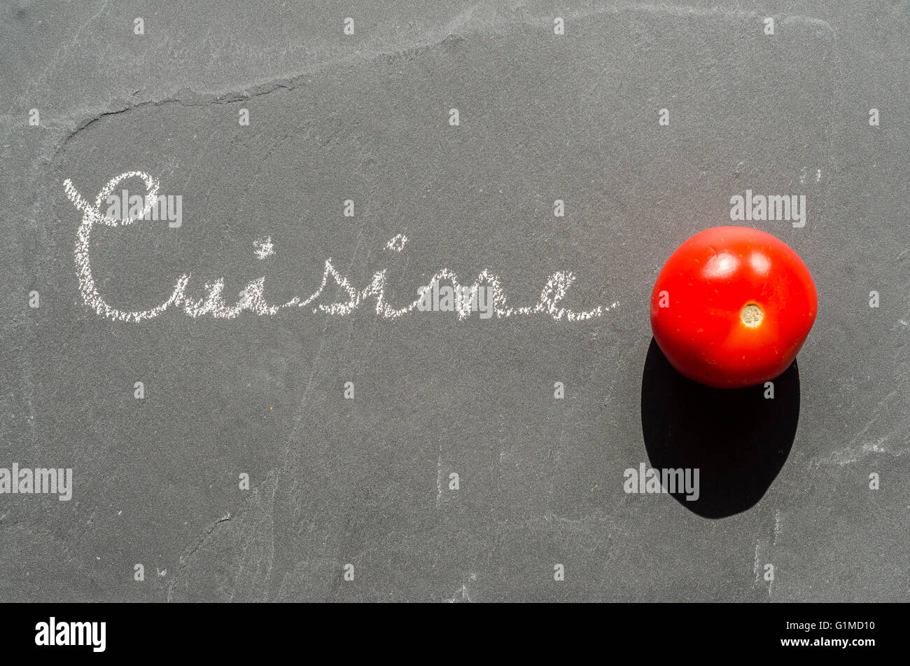 Tomate cerise sur ardoise - Stock Image