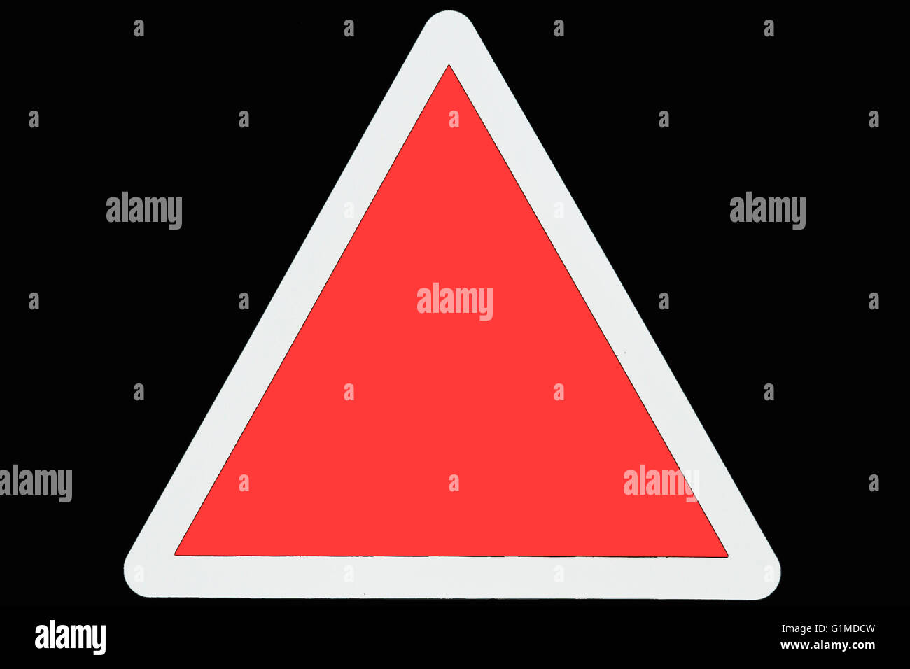 An empty red triangle road warning  sign with a white border - Stock Image