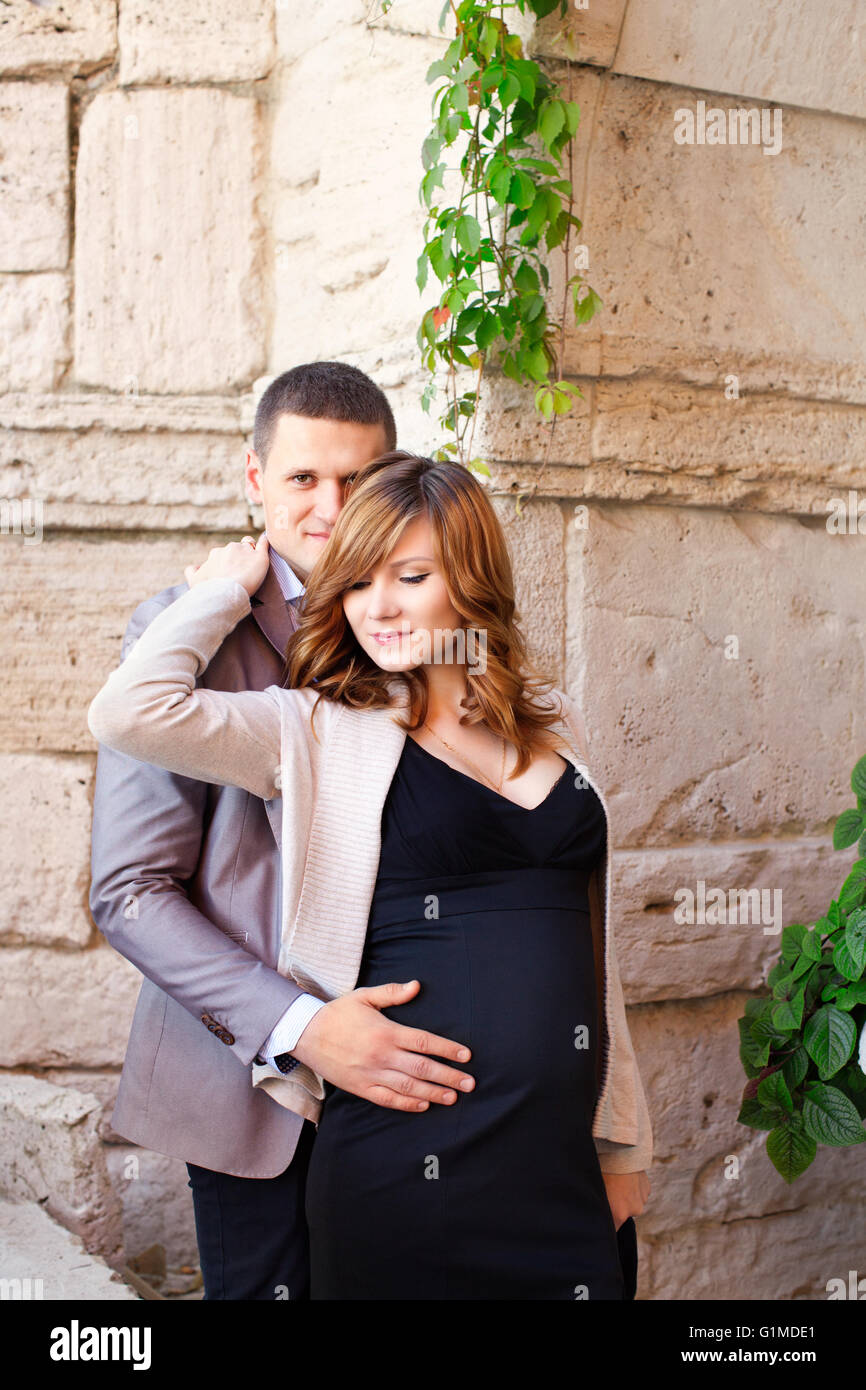 Man tenderly embraced Pregnant Woman - Stock Image
