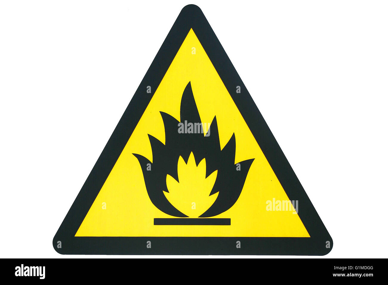 A triangular flammable gas or fire sign in yellow and black isolated on white. - Stock Image