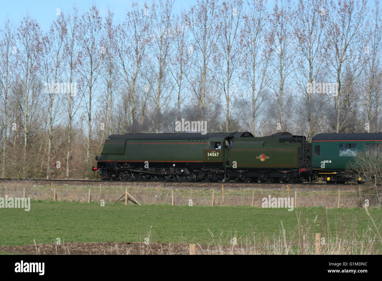 34067 Tangmere without nameplates climbs past Woodhorn with a Bath and Bristol charter from Three Bridges - Stock Image