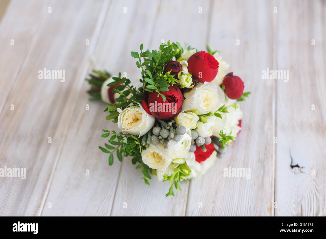 Beautiful And Colorful Wedding Bouquet Of Flowers Over Wood Table