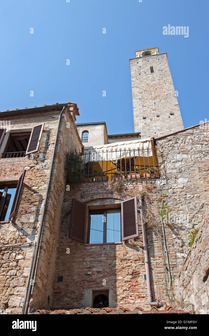 Old Tower and medieval houses in San Gimignano Tuscany, Italy - Stock Image