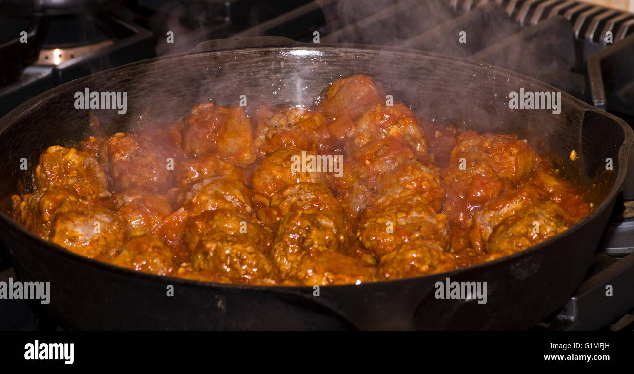 Meat balls cooking - Stock Image
