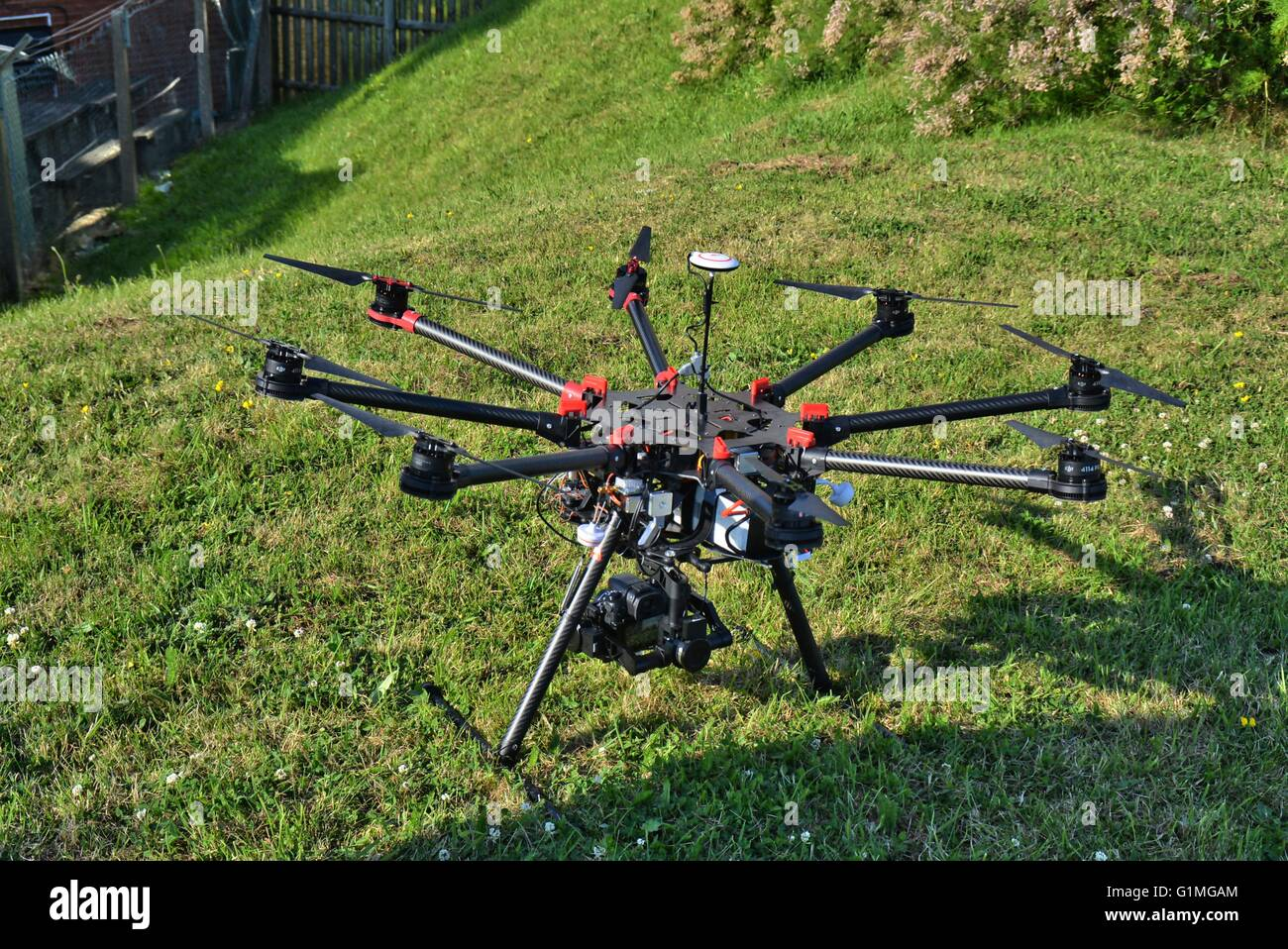 Drone photo of 8 rotor drone with Lumix professional camera attached on Gimbel, before take of for aerial video - Stock Image