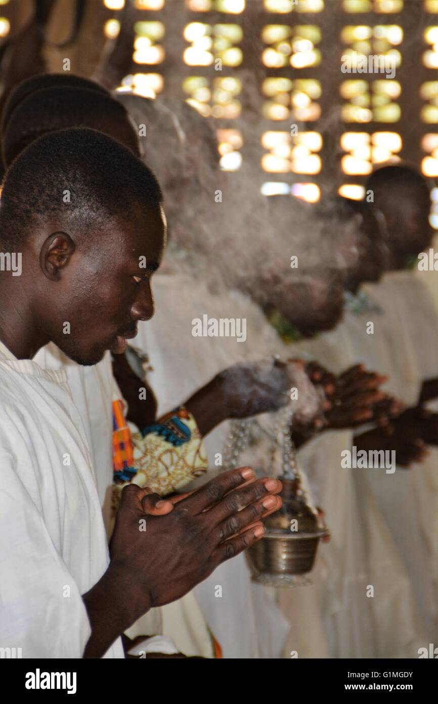 Catholic church, priests or monks praying at an altar of church in Ghana, Bolgatanga, West Africa / Africa - Stock Image