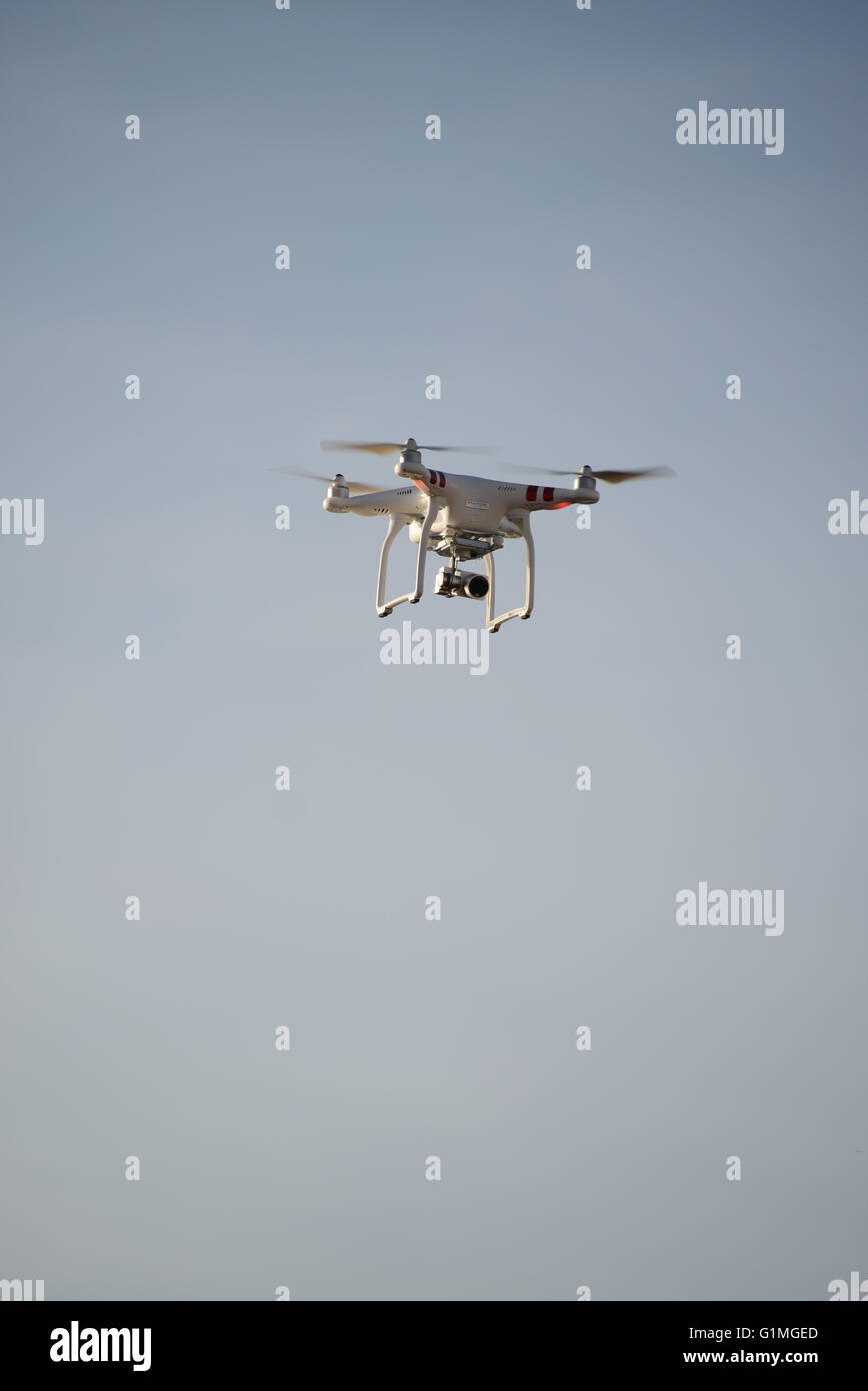 Drone flying in the sky - Stock Image
