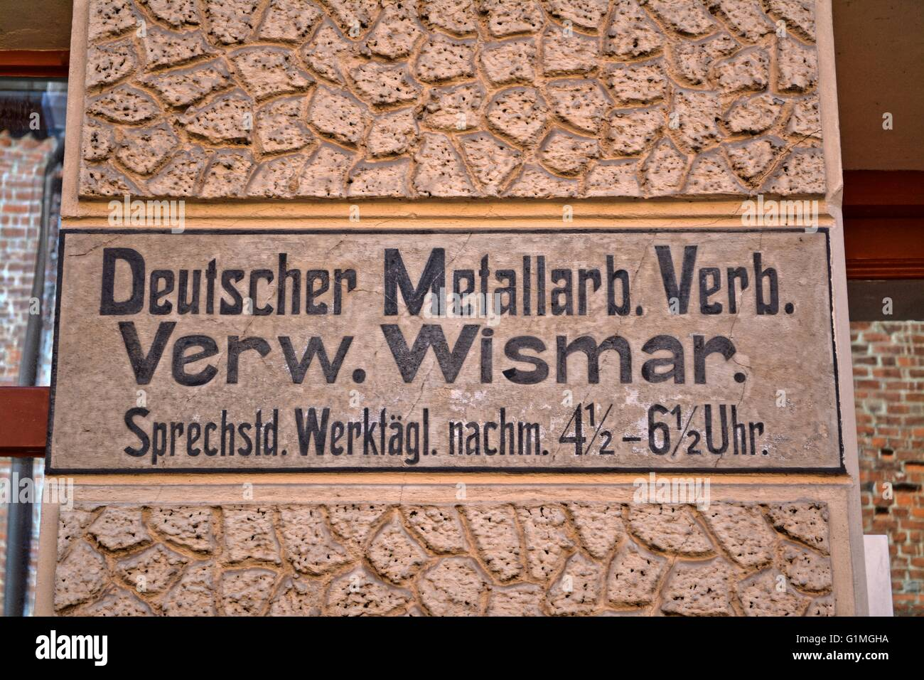 1900`s old wall advertisement, on a house wall in Wismar, Germany. German Metal Workers Union, head office Wismar. - Stock Image
