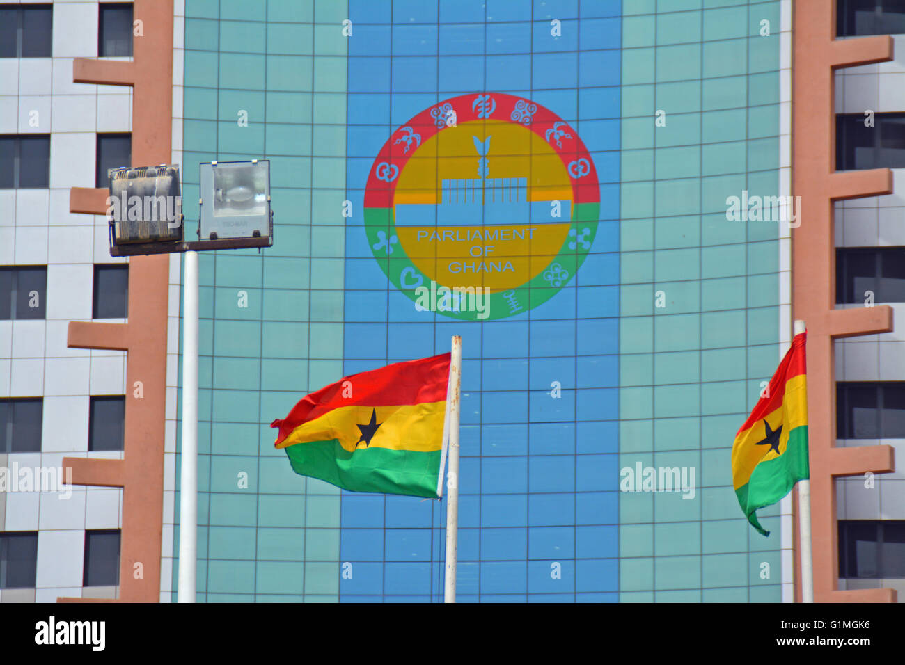 The newly refurbished Job 600 building of the Parliament of Ghana, shoving the parliament emblem and Ghana Flags - Stock Image