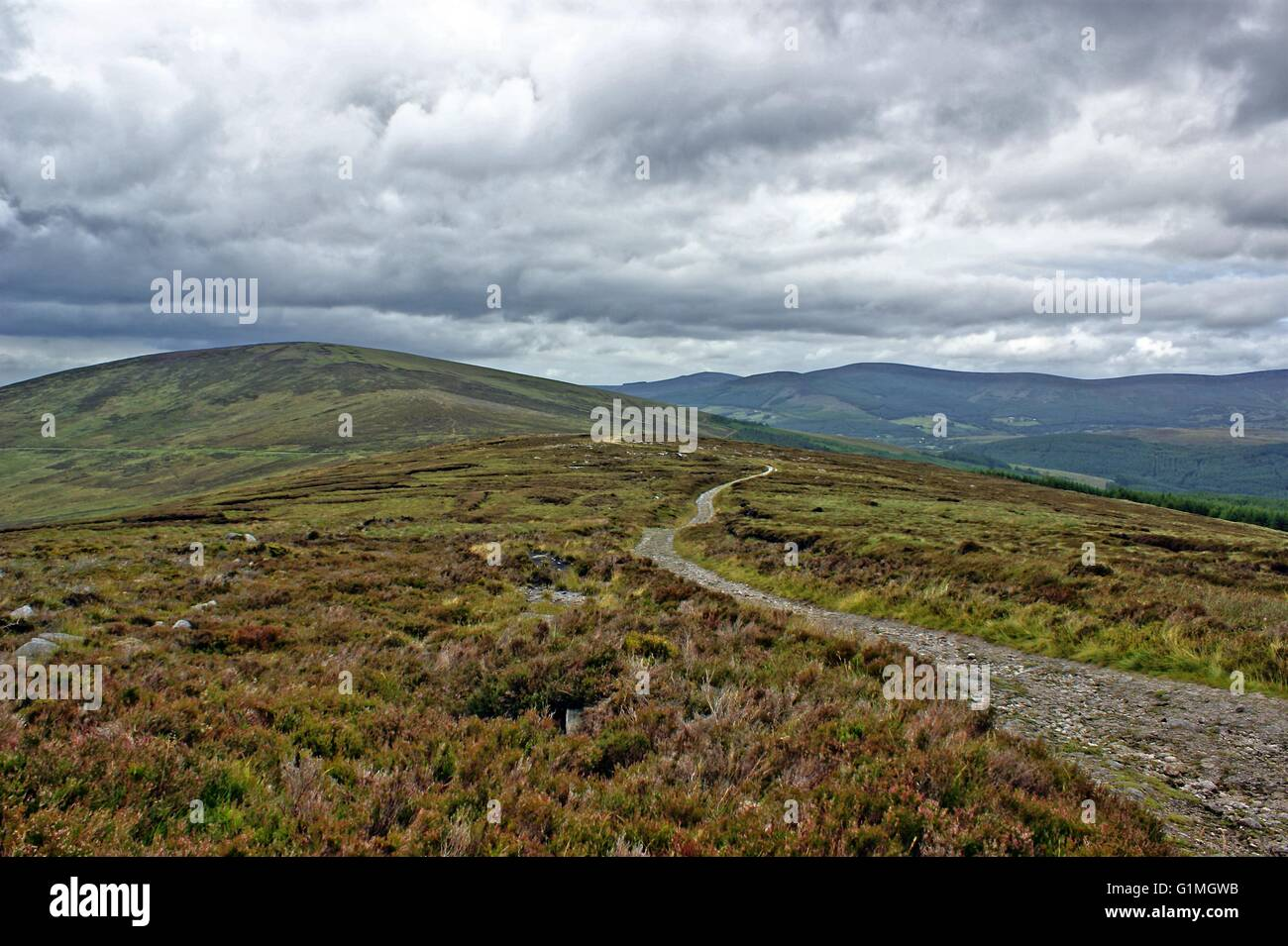 Irish mountain peaks in Ireland, near Dublin, Republic of Ireland, dramatic clouds and landscape, green grass. Stock Photo