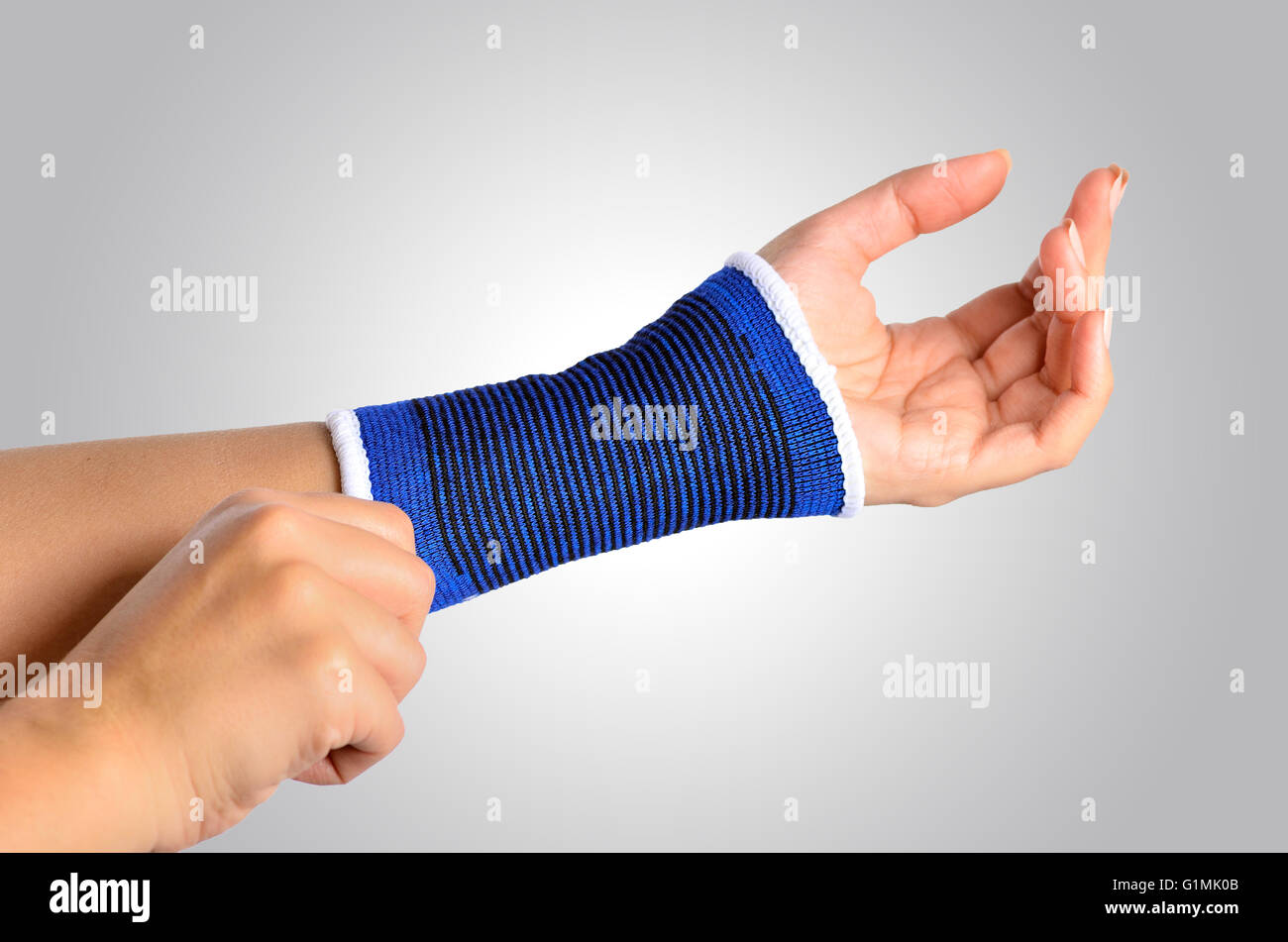 hand with a orthopedic wrist brace - Stock Image