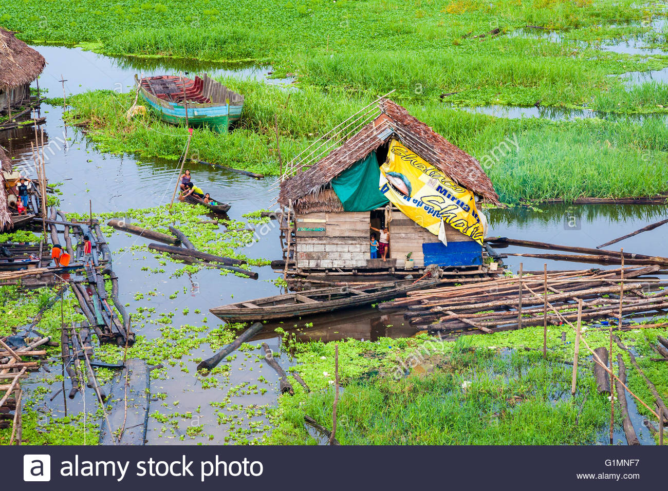 Woman and child in the doorway of their home on the Rio Itaya, Iquitos, Loreto, Peru - Stock Image